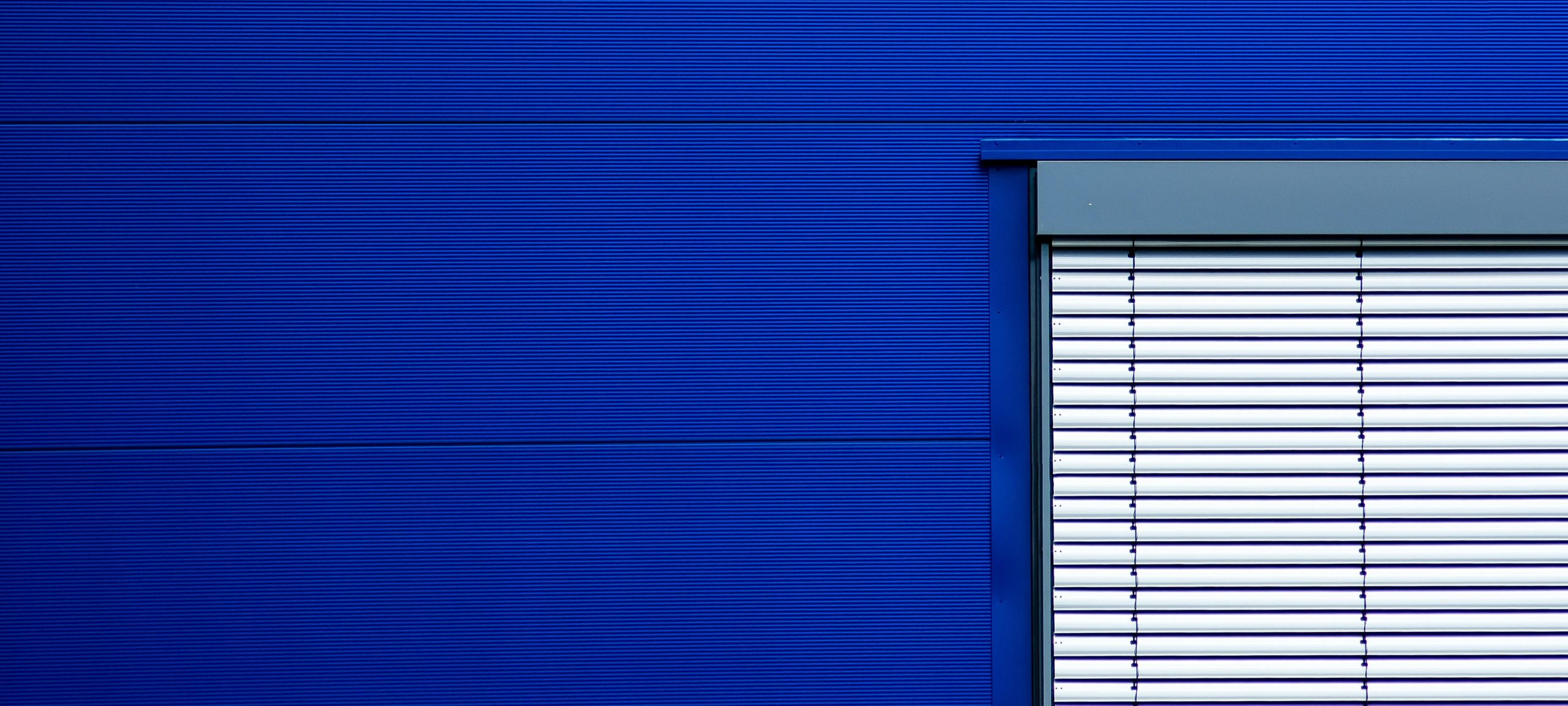 White window blinder on a blue background